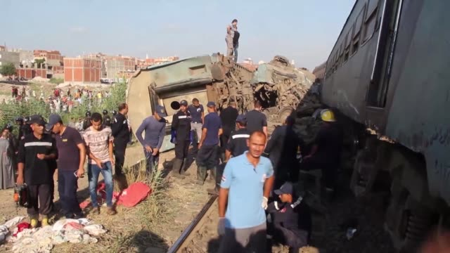 security forces inspect the site after two trains collided in khorshid district of alexandria egypt on august 11 2017 at least 49 people were killed... - train crash stock videos and b-roll footage
