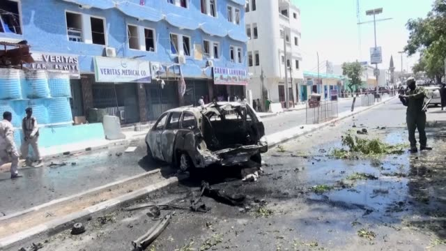 security forces inspect the site of a bomb attack after two car bombs targeted the weheliye hotel in mogadishu somali on march 13 2017 at least nine... - terrorism stock videos & royalty-free footage