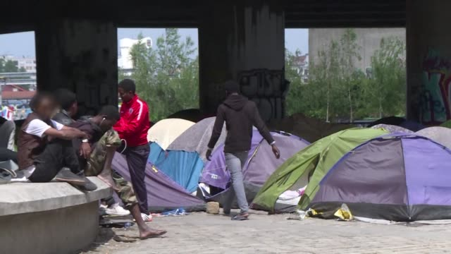 security forces moved in on the biggest migrant camp in the french capital on wednesday where some 1700 people lived in makeshift tents alongside a... - makeshift stock videos & royalty-free footage