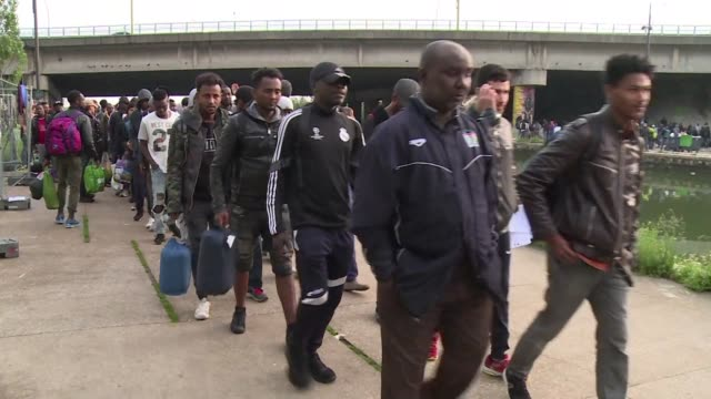 security forces moved in on the biggest migrant camp in the french capital on wednesday where some 1700 people lived in makeshift tents alongside a... - resourceful stock videos & royalty-free footage