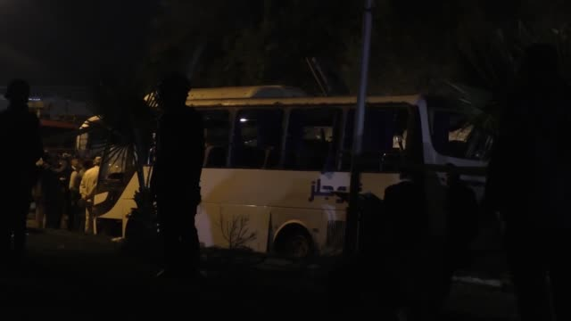 Security forces stand near a tourist bus after a roadside bomb in Cairo Egypt on December 28 2018 A roadside bomb killed two tourists and injured 12...