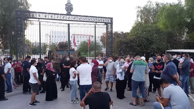security forces take security measures around parliament building as supporters of ennahda movement stage protest against suspending parliament,... - parliament building stock videos & royalty-free footage