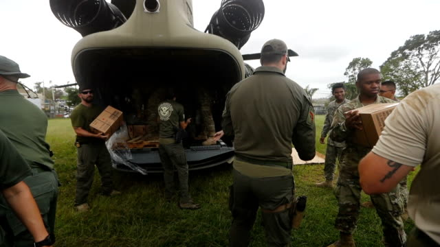 us security forces work delivering aid to an area without electricity and running water more than three weeks after hurricane maria hit on october 18... - 迷彩柄点の映像素材/bロール