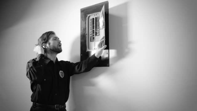 security guard checking circuit breaker - fuse box stock videos and b-roll footage