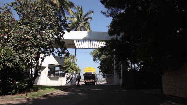 A security guard operns a gate at a Suhana spice factory in Pune Maharashtra India on Monday Nov 28 A truck carrying unprocessed spices enters a...