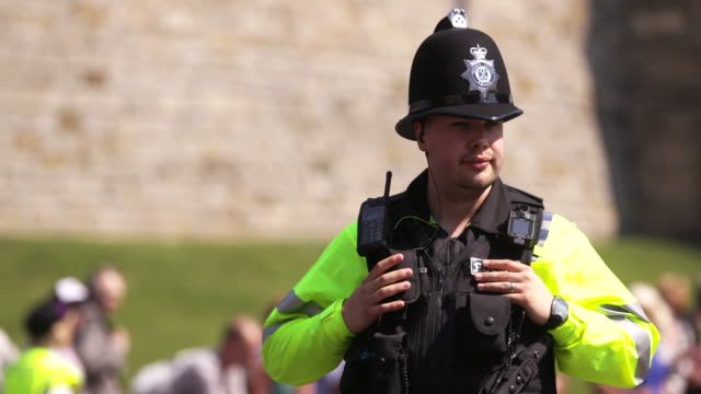 security guard outside of windsor castle in windsor, england - radio stock videos & royalty-free footage