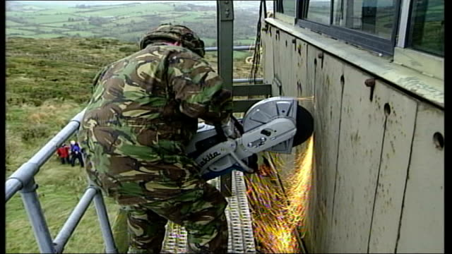 security installations; itn northern ireland: south armagh: int cbv soldier sitting behind machine gun in helicopter as along ext air view british... - security equipment stock videos & royalty-free footage