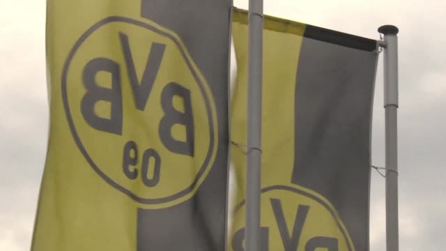 Security is tight at the Borussia Dortmund football club and fans gather to show their support after three explosions rocked the team's bus ahead of...
