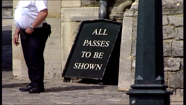 Man posed as senior detective at Windsor Castle ITN ENGLAND Windsor Castle Scots Guards band parade along Policemen on duty outside Windsor Castle GV...