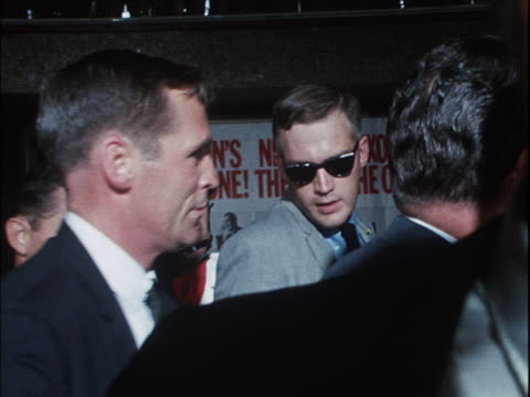 Security men push cameramen away as Richard Nixon arrives at the Republican Party convention in Miami