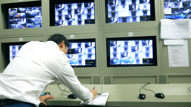 security officers working with noted - fare la guardia video stock e b–roll