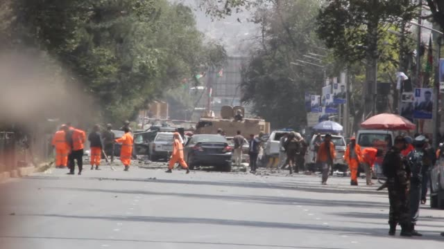 security officials gather at the site of a suicide bomb attack that targeted a checkpoint, in downtown kabul, afghanistan on september 05, 2019. a... - kabul stock videos & royalty-free footage