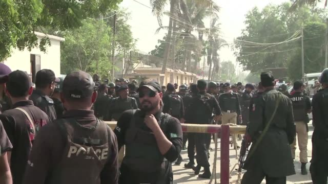 security officials gather outside the chinese consulate in the pakistani port city of karachi after it was attacked by unidentified gunmen - karachi stock videos and b-roll footage