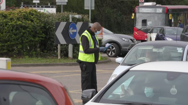 security personnel check the emails of nhs workers confirmed for testing at a coronavirus drive thru test centre at ikea in north london on april 1,... - e mail stock videos & royalty-free footage