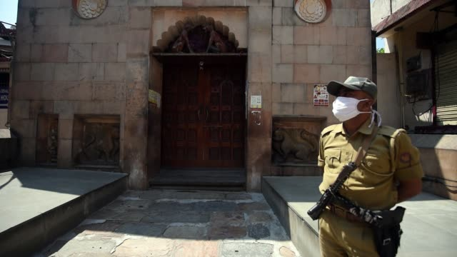 security personnel stand guard front of closed gate of kamakhya temple - indian politics stock videos & royalty-free footage