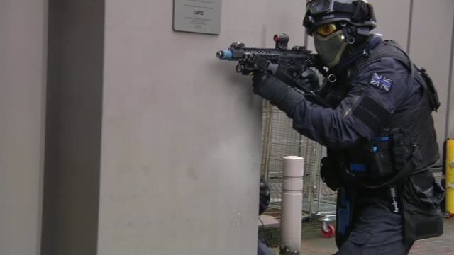 security risks in uk following raf airstrikes in syria england london ext various shots armed metropolitan police officers taking part in... - counter terrorism stock videos & royalty-free footage