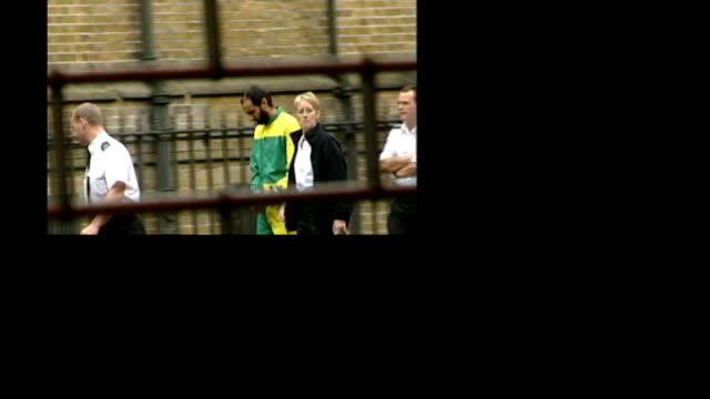 security services alleged to have bugged mp's conversations with prisoner various babar ahmad along in handcuffs / sadiq khan mp reading documents /... - security screen stock videos & royalty-free footage
