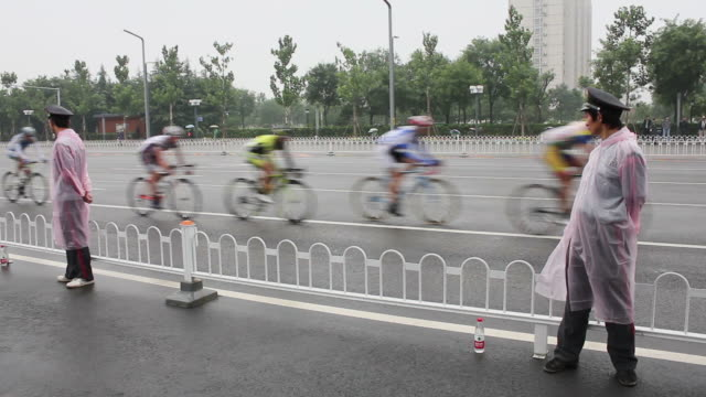 ws security staff 0f bicycle racing/xian,shaanxi,china - security staff stock videos & royalty-free footage