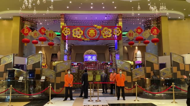 security staff at entrance to casino shut because of coronavirus epidemic macau china on wednesday february 5 2020 - 賭け事点の映像素材/bロール