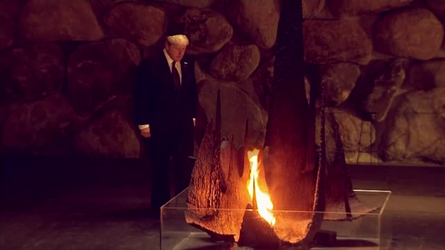 Security stepped up for Boris Johnson walkabout in Jerusalem after stabbing Johnson raising level of 'eternal flame' monument in Hall of Remembrance...