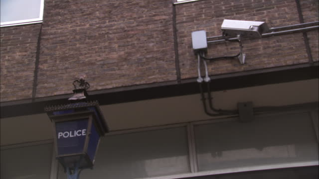 ZI, LA, Security surveillance camera on side of police building, London, England