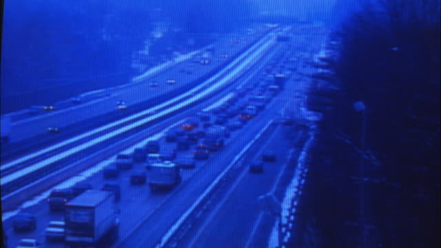 CU, Security surveillance monitor with view of traffic on highway