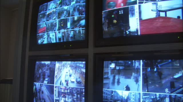 CU, PAN, Security surveillance monitors with view of London streets, London, England