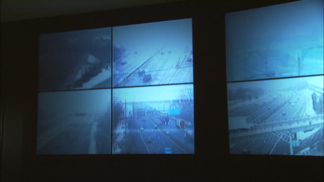 CU, PAN, Security surveillance monitors with view of traffic on highway