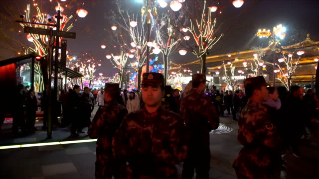 security team  at scenic spot for celebrate chinese spring festival / xi'an, shaanxi, china - 中国文化点の映像素材/bロール