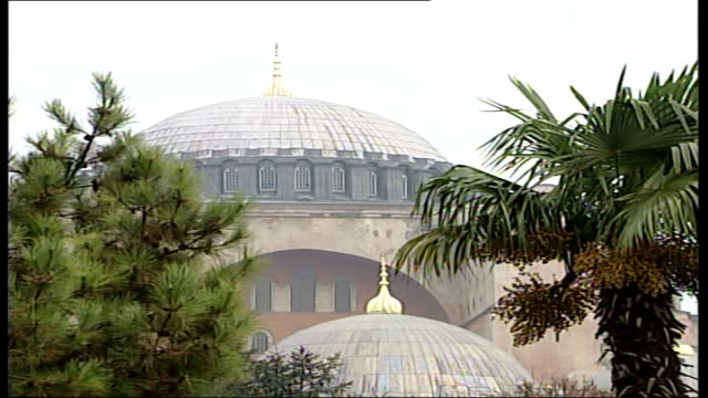 Security tight for papal visit General views Hagia Sophia mosque AntiPope banners Man giving out poster depicting Pope as a 'serpent'