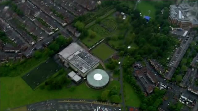 security tight in belfast before start of g8 summit: aerials; air views - aerials of protesters gathering / various of city / rally venue and stage /... - belfast stock-videos und b-roll-filmmaterial