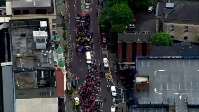 security tight in belfast before start of g8 summit; air view protesters marching along road - belfast stock-videos und b-roll-filmmaterial