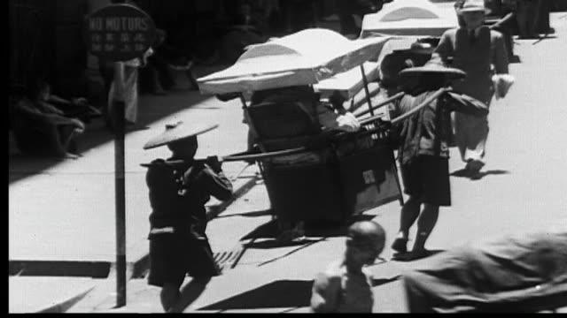 1938 sedan chair use in victoria, hong kong - 籠点の映像素材/bロール