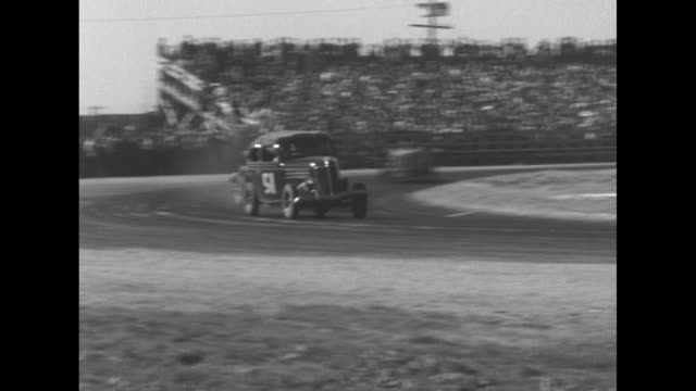 vídeos de stock, filmes e b-roll de vs sedans hot rods and model ts race on dirt track / spectators in stands / cars slide into one another on curve / vs race / one car slides into... - hot rod