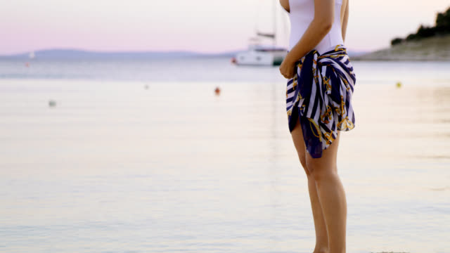tu seductive woman on a pier at dusk - sarong stock videos and b-roll footage