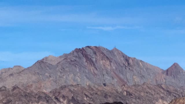 see this mountain change in nevada.  different photos of 1 mountain, at different times of the day. - nevada stock videos & royalty-free footage