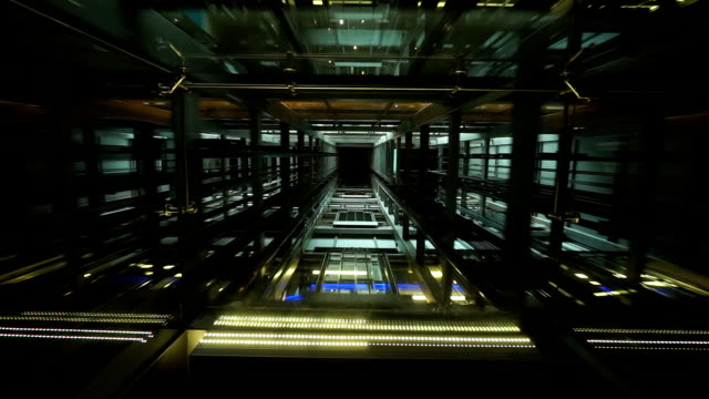 see through ceiling of elevator carriage showing elevator shaft and movement - moving up stock videos & royalty-free footage