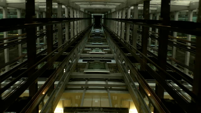 see through ceiling of elevator carriage showing elevator shaft and movement - lift stock videos & royalty-free footage