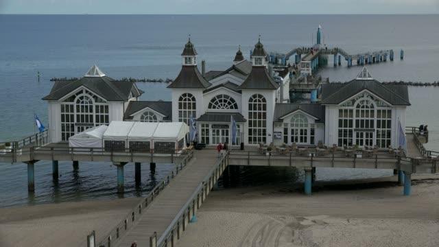 seebad sellin, seebruecke pier and beach, island of ruegen, mecklenburg-western pomerania, germany - pedestrian walkway stock videos & royalty-free footage