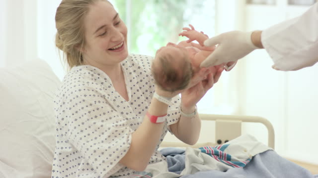 seeing her baby for the first time - fatcamera baby stock videos and b-roll footage