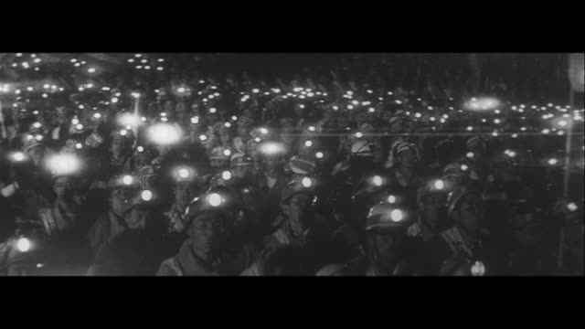 seeking a change on coal policy/1000 miners unionist enter tokyo from hokkaido kyushu night rally wavering headlamps mountain men protesting to... - 社会問題点の映像素材/bロール