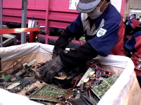 seeking to turn an environmental problem into an economic opportunity hightech companies in resourcepoor japan are mining mountains of toxic ewaste... - e waste stock videos & royalty-free footage