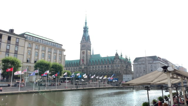 seen across an alster canal, the hamburg town hall (rathaus), the seat of the state parliament - rathaus hamburg stock-videos und b-roll-filmmaterial