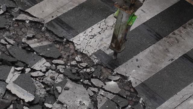 seen from above of démolition asphalte, road in construction - トラッキングショット点の映像素材/bロール