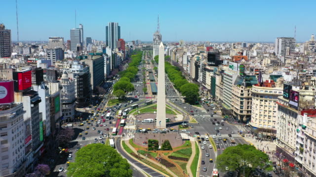 seen from distance, closing in, obelisk landmark in buenos aires and green letters ba - avenida 9 de julio stock videos & royalty-free footage