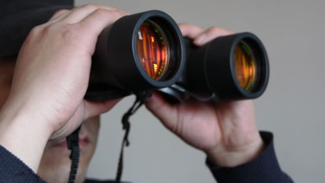 seen through a telescope - binoculars stock videos & royalty-free footage