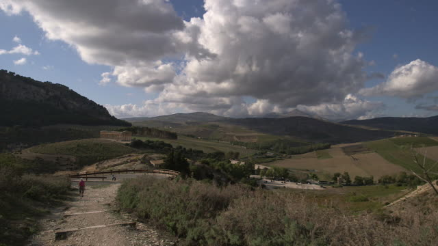 segesta, people walking to the vallley, the doric temple on the background - doric stock videos & royalty-free footage