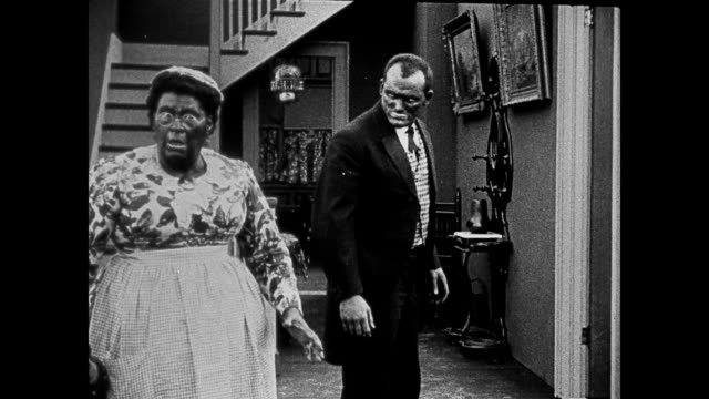 segment - fictionalized racist depiction of african american servant - portrayed by a actor in blackface - and guest. - xix secolo video stock e b–roll