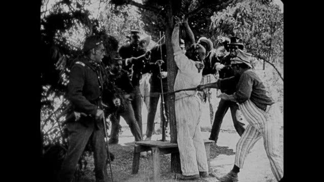 1860s an african american man is shot while intervening in a lynching - アメリカ黒人の歴史点の映像素材/bロール
