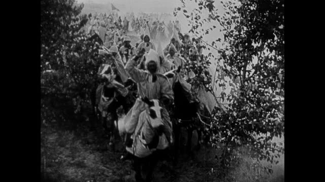 racist depiction - 1860s ku klux klan members ride horses through the woods - confederate flag stock videos & royalty-free footage
